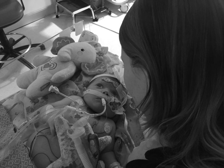 Congenital Heart Defects mom looking at Remington in ICU